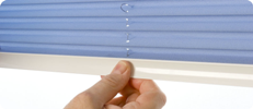Pleated and Cellular blinds using the Intu System are operated using a discrete tab handle on the bottom bar.